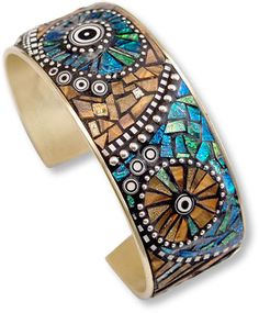 'Tribal Series Mosaic Bracelet'- Liz Hall: Brass cuff, polymer opal, faux wood, black and white cane slices, silver beads embedded in black grout..