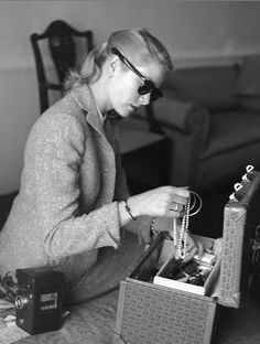 Grace Kelly, in Cannes for the Film Festival, putting away her jewelry at the Carlton Hotel, 1955
