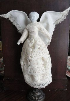 Antique re-dressed angel doll.  Handkerchief wings.