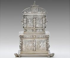 A Dutch silver tea caddy designed and modeled after a 17th century French armoire in the Musée du Louvre