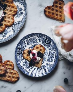 A waffle heart with whipped cream and blueberries  I must say I prefer mine with strawberry jam, but this was pretty darn delicious as well. What topping would you choose for these crispy waffles?