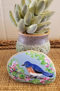 This is a very smooth OOAK painted river stone. Keep for yourself or give as a memorable gift. Perfect for Mom or a friend! This painted garden rock measures about 3.5 inches across and is painted in top quality acrylics and sealed with clear satin varnish so it may be used indoors or outdoors. Perfect for garden decor, in your potted plant, as shelf decor or a paperweight in the office. This piece is initialed on the side. It comes in a pretty blue drawstring pouch-- Enjoy! Hand Painted Rocks, Painted Stones, Small Gifts, Unique Gifts, Handmade Gifts, Gift For Lover, Gifts For Mom, Blue Bird Art, Online Gift