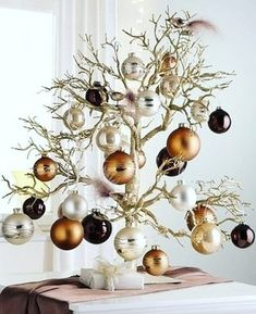 Cristhmas Tree Decorations Ideas : Tabletop Christmas Tree…love the branches and copper/silver/chocolate ornaments Tabletop Christmas Tree, Noel Christmas, Christmas Countdown, Xmas Tree, Winter Christmas, All Things Christmas, Christmas Crafts, Christmas Ornaments, Modern Christmas