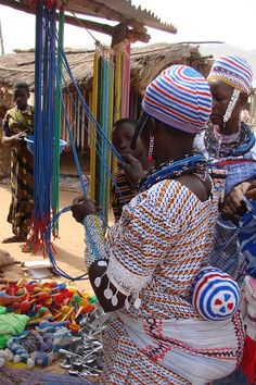 Bead vendor at market in the north of Benin, Africa. December 2009