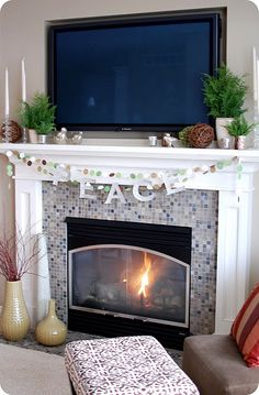mantel with TV decorating ideas | LIke the idea of putting a TV above my mantel | home decor