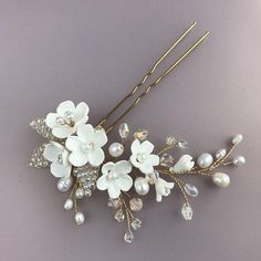 Shop for Wedding Hair Accessories with white flowers and crystal leaves for wedding floral style. Our headpiece this is exquisite bridal jewellery bridal hair pieces and hair accessories Very beautiful decoration for your royal hairstyle. In this hairpin we used white clay flowers,