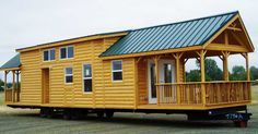 Portable 380 sq ft log cabin… you will love the two porches and secret storage stairs!