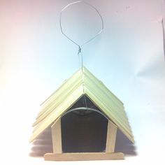 Make a Popsicle Stick Bird House. Find more free DIY guides on your Iphone at http://goo.gl/NDawcr or your Android at http://goo.gl/p3iHWy #BirdHouse #GardenDIY #DIY #guidecentral
