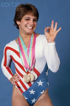Mary Lou Retton - Summer Olympics 1984  I was 7 then and remember it clearly. K-mart sold a leotard just like this for little girls. I wore it constantly. :)