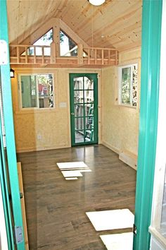 Tiny House with a Flip Up Porch View of living area from bath door.