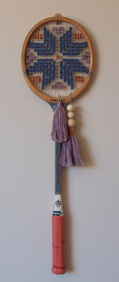 Woven / Cross stitched vintage squash racquet. Gorgeous vintage racquet featuring a lovely pattern with plump tassels with copper rings.