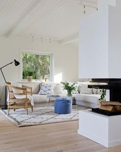 Light living room with fireplace in a summerhouse in Sweden
