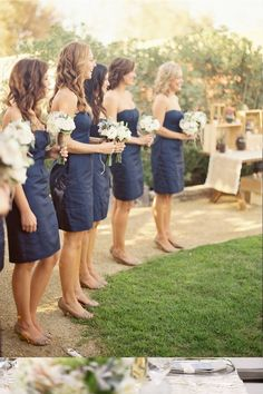 Navy bridesmaids dresses & white flowers <3 Would be cute if groomsmen were wearing grey suits.