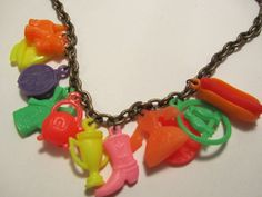 Vintage Plastic Charm Necklace on Brushed Gold Chain by chaosintoartdotcom, $15.00
