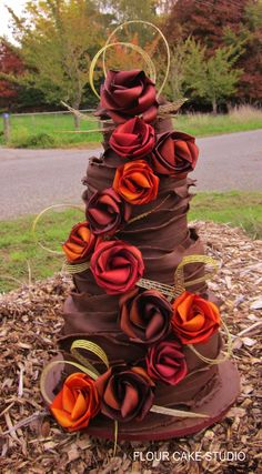 Large wedding cake by Flour Cake Studio and flax flowers by Flaxation.  www.flaxation.co.nz
