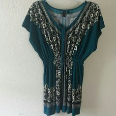 """CLEARANCE!!! Beautiful Tunic Top Beautiful teal tunic top. Spandex. Approx length 28"""". No damages or stains. Tops"""