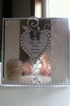 like concept clear piece in middle overlaid with die cut, add pearls - Handmade card from May Hume