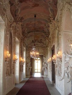 Satyr Cabinet Hallway in Ludwigsburg Palace, decorated in ornate stucco work and Baroque sculptures.
