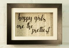 Happy Girls Are The Prettiest Audrey Hepburn Inspirational Quote Upcycled Vintage Book Page 6x8 Framed Art Shadow Box. We love to give new life to old books with messages of hope, love and strength. We up-cycle the beautiful, weathered pages to create unique prints that glow with the patina of another age, so no two are alike. The result is a beautiful and interesting home decor print. Definitely a conversation starter! Our prints are currently created using vintage books rescued from...