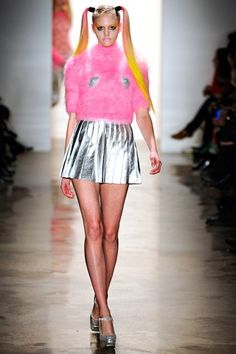 Because the Day-Glo, baby-wabie, '90s rave look was due its glorious-hideous comeback.  From Jeremy Scott Fall 2011.