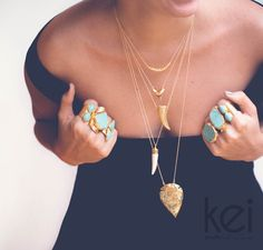 Layered turquoise chunky rings and fine chain necklaces from Kei Jewelry.