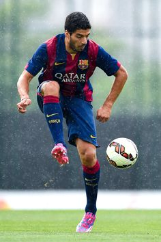 Luis Suarez of FC Barcelona controls the ball during a friendly match between FC Barcelona B and Indonesia U19 at Ciutat Esportiva on September 24, 2014 in Barcelona, Catalonia.