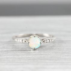 Opal and diamond engagement ring handmade in rose white yellow