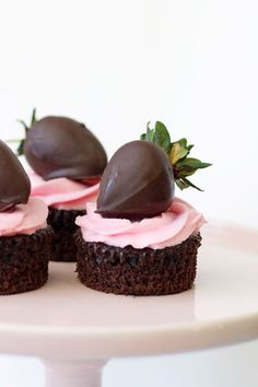 chocolate cupcake topped with strawberry frosting and a chocolate covered strawberry