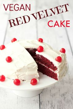 Rich, moist and smooth vegan red velvet cake topped with lemon buttercream frosting and maraschino cherries. #vegan #dairy-free #lovingitvegan