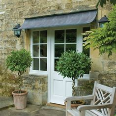 "Scoop door canopy. ""Door canopies offer wet weather protection and shelter for you and your door."""