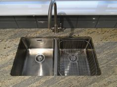 A great shot from one of our customers of the Bluci Orbit 02 double bowl stainless steel undermounted kitchen sink. Shame they didn't fit the overflow plate before taking the picture! Sink Taps, Sinks, Designer Kitchen Taps, Spray Insulation, Double Bowl Kitchen Sink, Real Kitchen, Waste Disposal, Corian, Great Shots