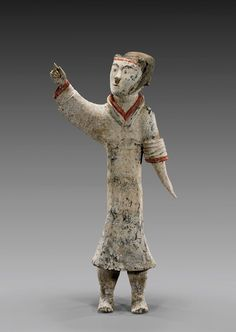 """HAN DYNASTY PAINTED POTTERY OFFICER Tall and highly unusual, Chinese Han Dynasty, finely painted and high-fired pottery figure; of a slim stylized officer pointing and looking upwards to his right, with much original pigments remaining; H: 25 3/4"""", lucite stand; Oxford TL Test #C198z38 Painted Pottery, Pottery Painting, The Han Dynasty, China Art, Lion Sculpture, Oxford, Objects, Chinese, Slim"""