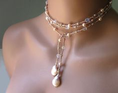 Beaded Lariat Necklace Baroque South Sea Peach Pearls Women's Jewelry Gift Wear Wrap and Go Lustrous South Sea Baroque Light Peach Pearls measuring h x dangle at each end of the stylish beaded lariat. Overall Lariat length measures 4 feet 5 inches. Pearl Jewelry, Bridal Jewelry, Jewelry Gifts, Beaded Jewelry, Jewelry Necklaces, Handmade Jewelry, Beaded Earrings, Jewelry Ideas, Feet Jewelry