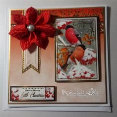 Made by Julie - I have used Festive Birds of Britain card kit for this card, I have used a ribbon poinsettia to add texture.