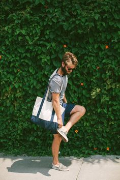 White Blue Tote Bag styled with Plain Grey T-shirt and a pair of Shorts which is…