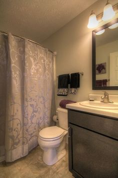 Beautiful Purple And Silver Bathroom Featuring A Rotator Rod Shower Rod At  300 At The Circle Apartment Community In Lexington, KY.