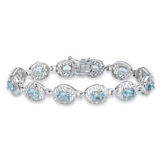 Radiating gorgeous color and on-trend style, our tennis bracelet wraps your wrist in 6.84 carats of genuine blue topaz o-cNOK0Z4r
