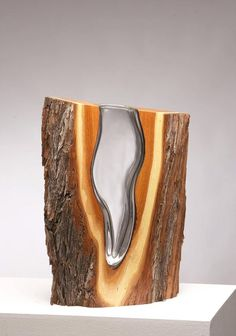 """To create the mesmerizing sculptures in his Wood & Glass collection, American artist Scott Slagerman draws the designs on to the wood, cuts the pieces out using traditional woodworking techniques and blows the molten glass directly into the cutout shapes to combine the contrasting materials. """"Scott Slagerman has always been captivated by glass – how it is transformed from a fragile, yet unyielding solid state to molten fluidity and back again; and how this mutable substance, th..."""