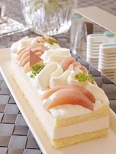 「桃のムース」角セルクル 210×80×50 mm を使ったケーキです。ケーキスライサーもあると便利です。【楽天レシピ】