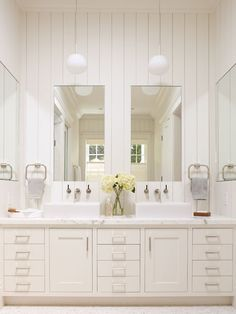 Marble Topped Vanity And Recessed Medicine Cabinets Plus Modern Pendants  Lighting Provide Additional Light And Painted Solid Board Paneling In  Master ...