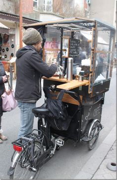 many big and little trends that emerge here and across Europe.  One is coffee, roasted on the premises in Paris, as well as the coffee cart…here is a pedal-cart at the flea market.  It was so cold on Saturday morning, I asked him if he had any cognac on that cart.  No, but the gregarious young vendor whose shop we were in front of said he had a bottle handy.  This was a really great cappuccino on the go while antique shopping, and he also makes amazing fresh-pressed orange juice~
