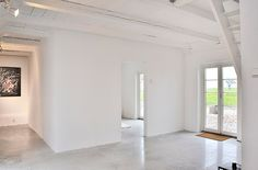 white wash walls and ceiling with white concrete floor
