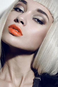 Love this pop of color on her lips...and the platinum blonde hair that actually goes well with her skin. --- Photo: Tony Veloz