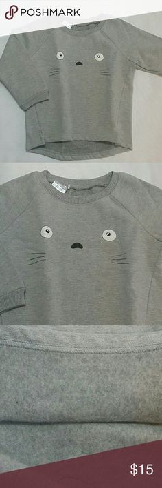 NWOT Gray Kitty crew neck sweatshirt Adorable and warm crew neck sweatshirt with a cute design on the front.  Very cute item  This item is brand new and never used Shirts & Tops Sweatshirts & Hoodies