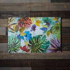Print on canvas. Tropical flowers and foliage in bright colors on a white background.