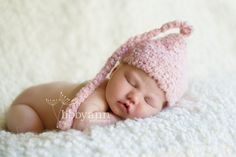 Love the soft faux-sheepskin backdrop (and the precious hat)