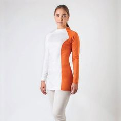 Designed and made in Perth, the Bon Voyage Top is made entirely from Australian merino wool with a mock-turtleneck. Merino has a natural elasticity which makes this top perfect for travel, work or casual occasions. Shop the look at thedresscollective.com ✔️