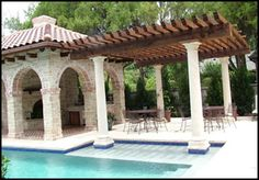 Love this pergola by the pool