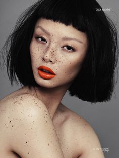Freckles and red orange lips