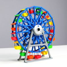Fully printable Ferris wheel rotating on two printed bearings. Printed on Zortrax M200 3D Printer.  Filament: Red Z-ABS Green Z-ABS Yellow Z-ABS Orange Z-ABS Blue Z-ABS Pure White Z-ABS Cool Gray Z-ABS  Printing Parameters:  Layer Height: 0,14mm  Infill: Full  Support: 0°-30°